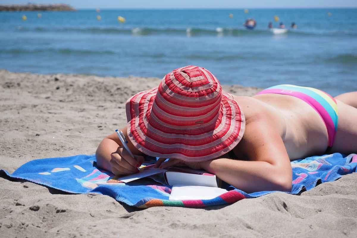 girl sun bathing on the beach