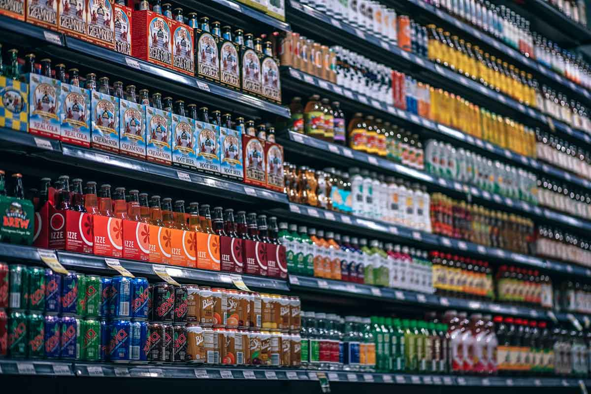 soda and sugary beverages in grocery aisle