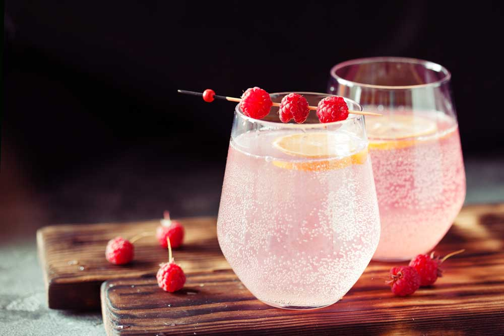 Berries and fruit in sparkling water to infuse flavor