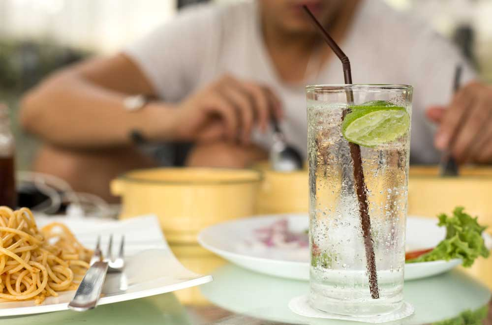 lime in sparkling water to spruce up flavor