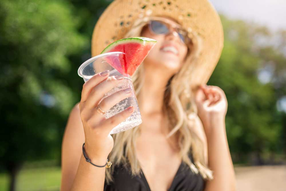 girl drinking sparkling water in the summer